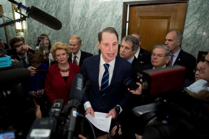 Sen. Ron Wyden, D-Ore., ranking member of the Senate Finance Committee, center, accompanied by, from left, Sen. Debbie Stabenow, D-Mich., Sen. Bill Nelson, D-Fla., Sen. Sherrod Brown, D-Ohio, Sen. Robert Menendez, D-N.Y. and Sen. Bob Casey, D-Pa., speaks in the hallway on Capitol Hill in Washington, Tuesday, Jan. 31, 2017, to discuss opposition to Human Services Secretary-designate, Rep. Tom Price, R-Ga.