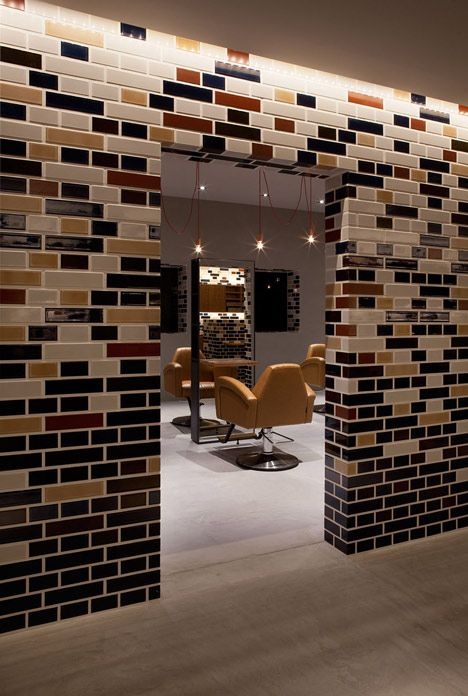 Architect Hiroyuki Miyake used a traditional English bricklaying pattern for the ceramic tiles on the walls of this beauty salon in Toyokawa, Japan.