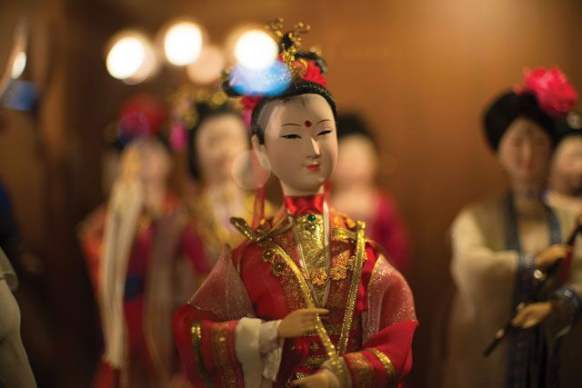 Ladies in red: traditional Chinese dolls, in their elaborate costumes and headdresses, smile daintily at the Chiang Mai Doll Making Centre and Museum. Photo: James McDonald