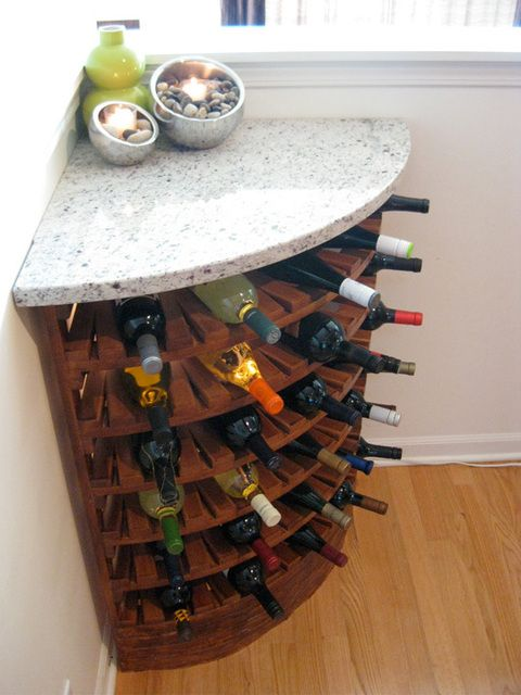 corner wine cupboard? I like this, but I'd also like this type of shelving layout for cookbooks in a spare corner near/in the kitchen (hahaha, in the kitchen. There's never a spare corner in those.)