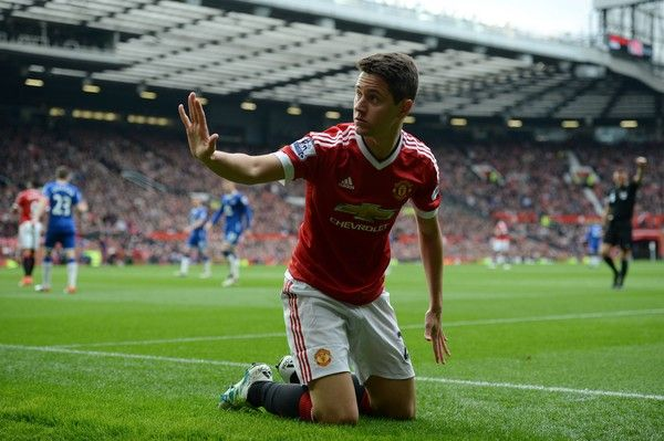 Manchester United's Spanish midfielder Ander Herrera raises a hand to a member of the crowd after his attempted cross went into the crowd and hit a fan during the English Premier League football match between Manchester United and Everton at Old Trafford in Manchester, north west England, on April 3, 2016. / AFP / OLI SCARFF / RESTRICTED TO EDITORIAL USE. No use with unauthorized audio, video, data, fixture lists, club/league logos or 'live' services. Online in-match use limited to 75…