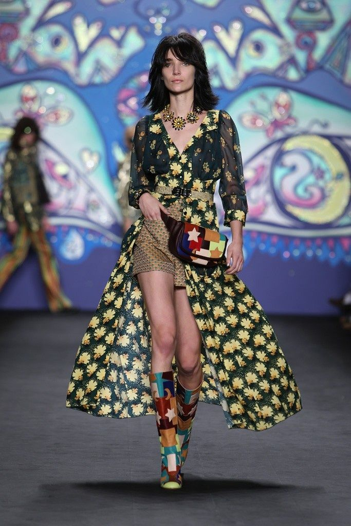 Anna Sui is clearly excited about spring, and opts for yellow flower shapes as accessories and boho dress coats scattered with cheerful yellow African marigolds.