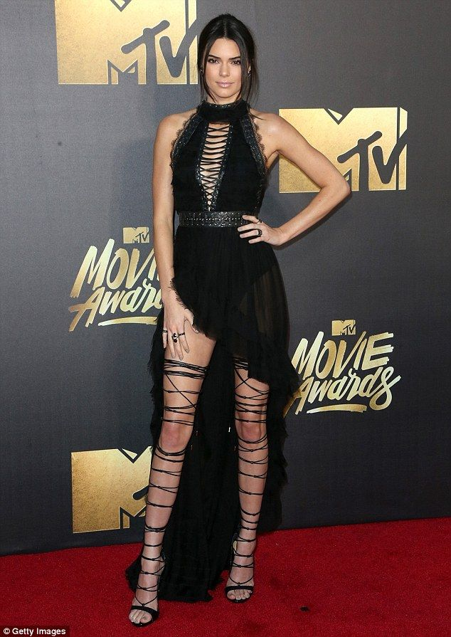 All tied up! Kendall Jenner, 20, wore a lace-up ensemble as she attended the 2016 MTV Movie Awards on Saturday night