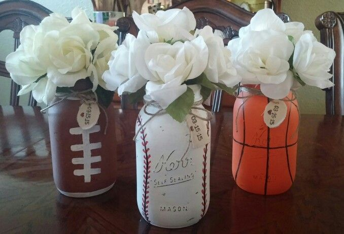 Sports theme mason jars used acrylic paint to give it a distressed look. You will have to give it a few coats of paint. I did 3 :) Perfect for birthday parties, weddings for big sports fans, used these for a baby boy shower. Flowers from dollar tree! Very cute and simple