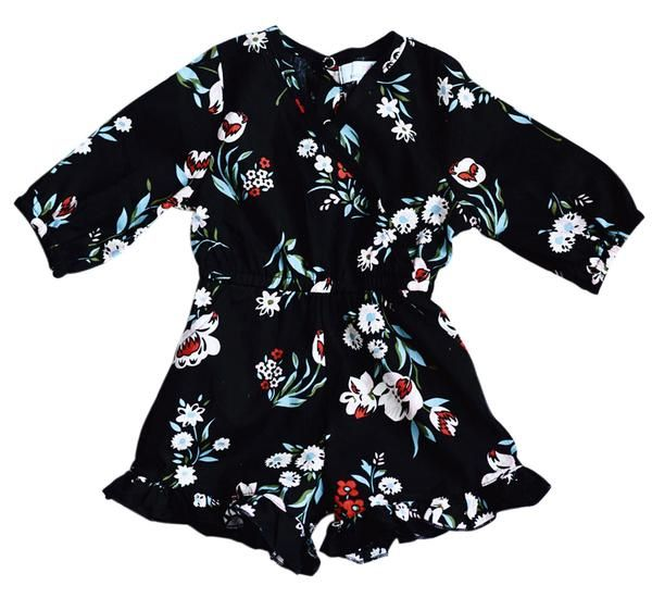 Gorgeous black floral print is the highlight of this darling jumpsuit romper! With two side slant pockets, snaps at both the back and the *bottom for easy chang