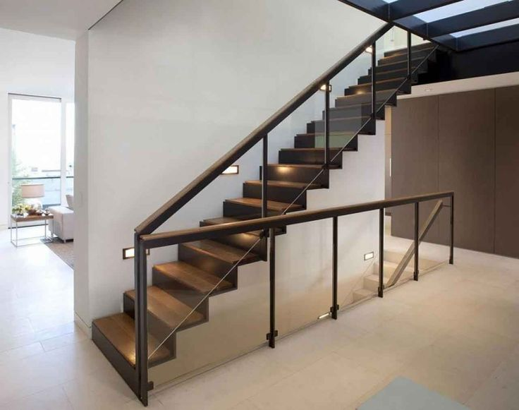 Stunning wooden staircase design with clear glass baluster and wooden handrail