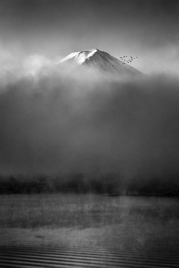 Mount Fuji rising above the morning fog at Kawaguchiko Lake, Yamanashi, Japan