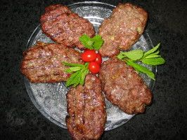 Gyro Burgers - WOW. Just wow. Made this on a whim and I will be making it again very soon. I substituted balsamic vinnagrette for the red wine vinegar and added feta cheese to the mix. Delicious!