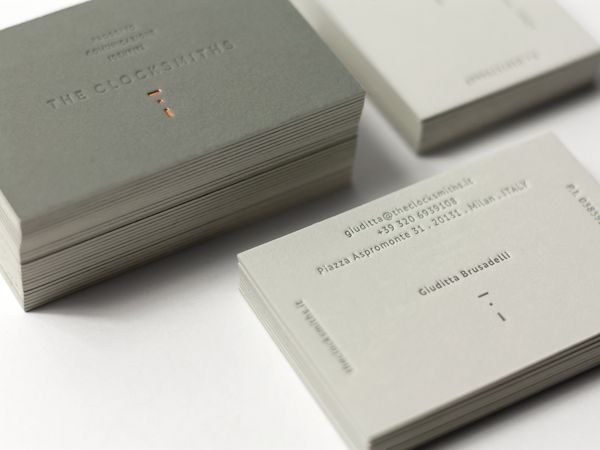 Duplex business card with copper foil and blind debossed detail designed by and for The Clocksmiths.
