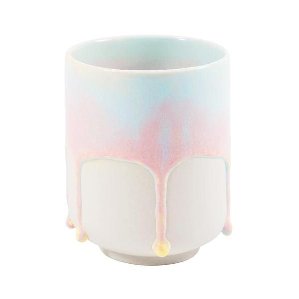 Small hand-cast porcelain cup for the quick espresso and creamy cortado.Glazed with a thick, patterned blue-pink glaze.