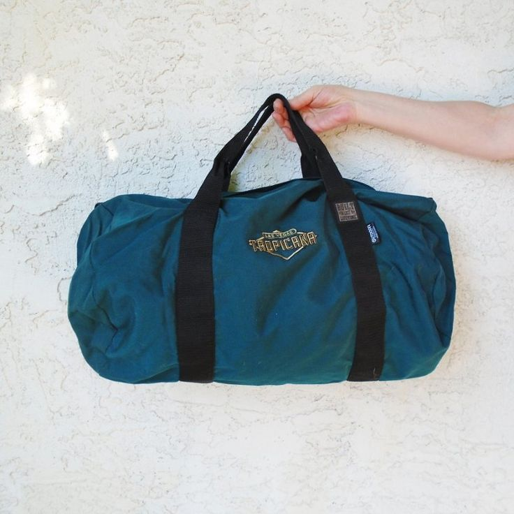 Tropicana Hotel Casino Las Vegas Duffle bag. Teal in color. Measures approximately 23x18x12 inches. Looks to be unused.