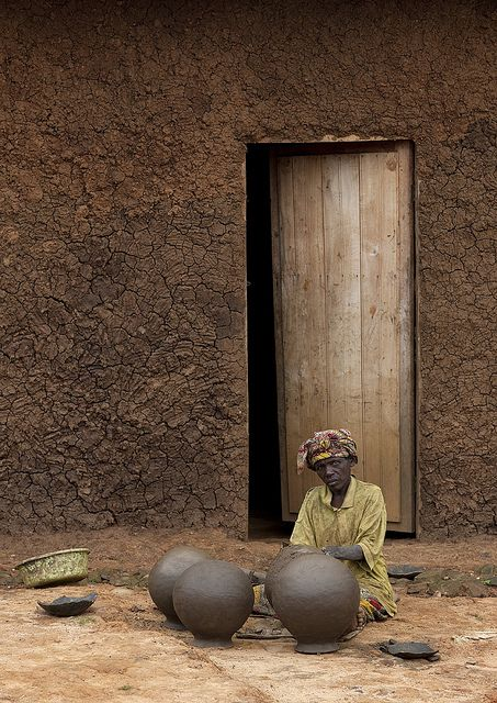The Twa, aka the Batwa, are a pygmy people who were the oldest recorded inhabitants of the Great Lakes region of central Africa. They now live in Rwanda, Burundi, Uganda, and the eastern portion of the Democratic Republic of Congo. Thanks to the pottery they make and sell in Kigali shops, they are able to build big mud houses in many villages.  This photo was taken in Rwanda by Eric Lafforgue