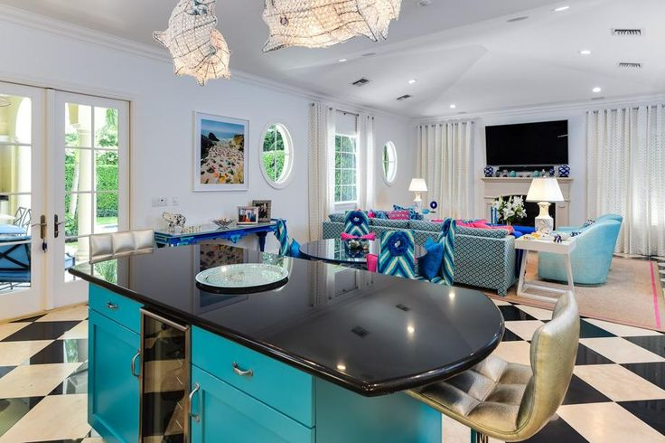 With the open plan, one can see over the kitchen island into the living room. Photo by Andy Frame, courtesy Christian