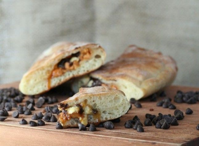 22. Peanut Butter and Double Chocolate Calzone: With this tasty calzone packed full of peanut butter cup flavor, you can easily make a two-course meal out of tasty filled breads. (via It's a Lovely Life) - 115 Filled Foods to Stuff Yo' Self Silly With via Brit + Co.