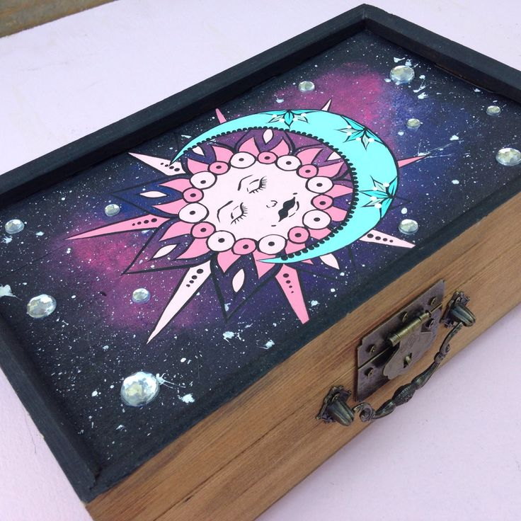 Wooden keepsake box to hide your valuables, weed stash, jewelry or whatever youd like ! Hand painted sun & moon with a galaxy back ground. Great for yourself or even a gift ! •Hand painted/ stained •2 Removable shelves for more storage •Perfect gift or self use •Mirror inside lid ***Please be sure to check out the demensions before purchasing, thank you ! Approximately L 10 inches W 6 inches D 3 inches