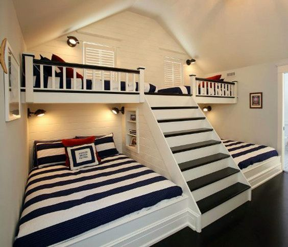 (link broken) Built in bunk beds, 2 twin up top and 2 full on bottom with stairs. Would be nice to use the space under the stairs for things or a hiding spot somehow