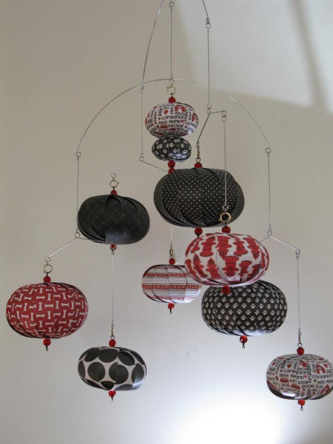 Hanging mobile black red white dog bone fire by LMackeyCreations