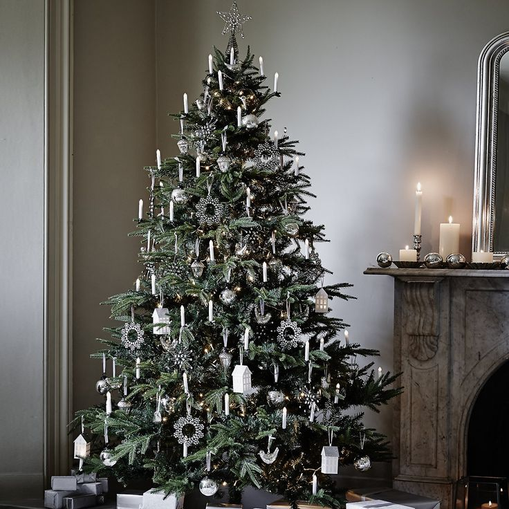 White and silver Christmas tree with fairy lights. For more Christmas  decorating ideas like this