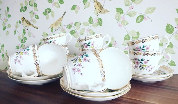 A set of ten pretty bone china cups and saucers by English maker Royal Grafton.