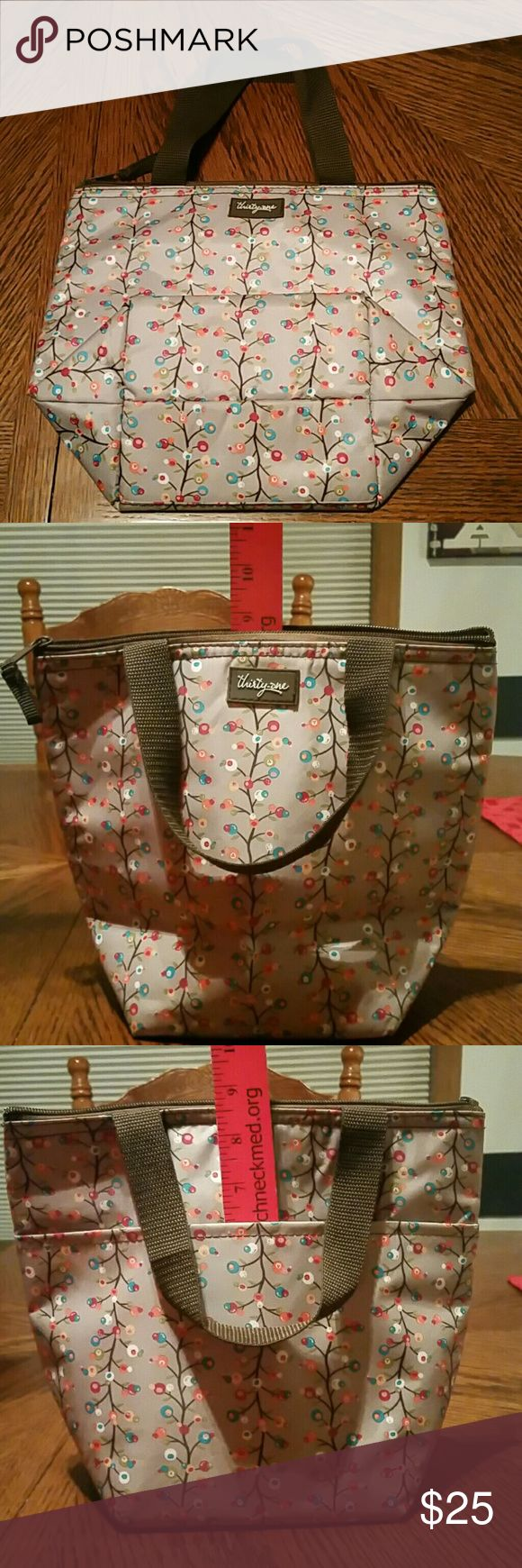 Thirty-one Thermal tote Thirty-one Thermal tote NWOT 9 inches tall 4.5 inch strap drop 10.5 Width 5 inches bottom width Thirty-one  Bags Totes