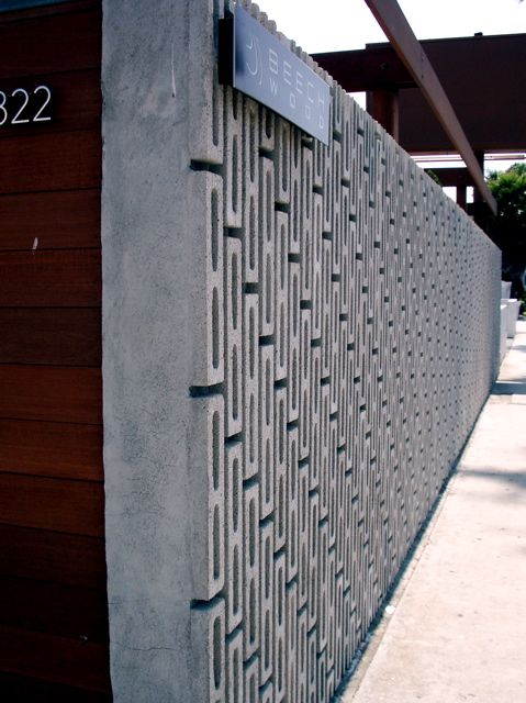Concrete fence.  Repinned by Secret Design Studio, Melbourne.  www.secretdesignstudio.com