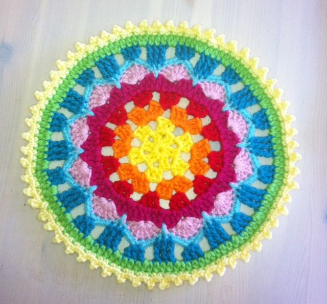 I recently saw a similar mandala from a German crochet artist and created this tutorial. I am crazy about these colors, and am so pleased a...