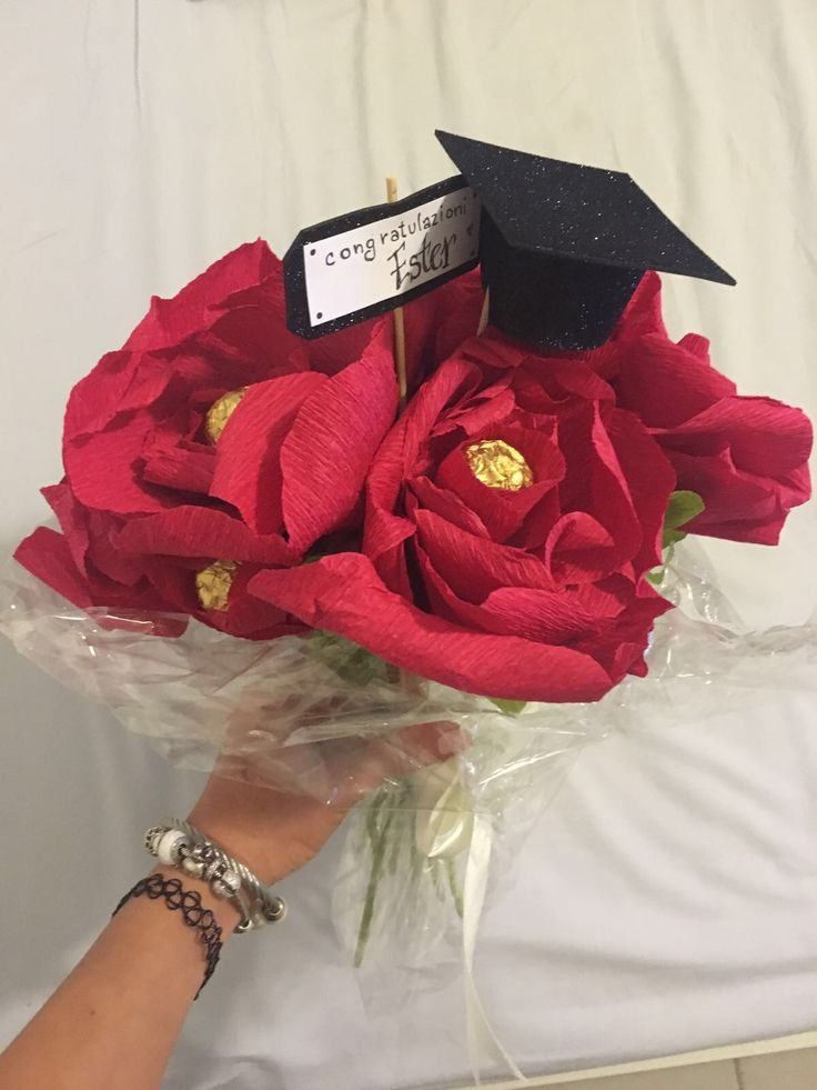 Graduation day present. Flowers with Ferrero rocher. Laurea