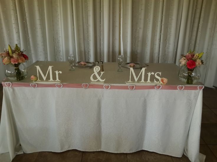 Bridal table with Mr & Mrs signs and pink heart buckle detail