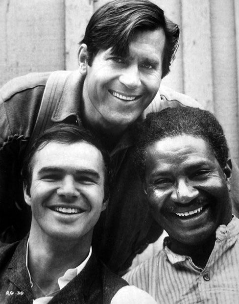 Burt Reynolds, Clint Walker and Ossie Davis relaxed on the set of Sam Whiskey