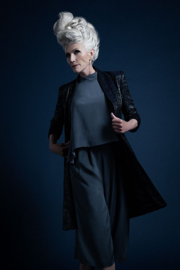 Model Maye Musk wearing Navy Metallic Over Coat by Theia over Grey jumpsuit by Tibi