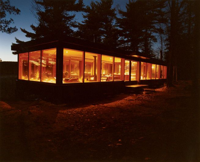 Named Barerock, a couple's three-season, 900-square-foot lakefront cottage above Drag Lake, near Haliburton, Ontario is encased in mirrored windows that offer sweeping panoramic views of the surrounding forest. At night, it appears to glow like a lantern. The cabin took two years to build and cost less than $165,000.