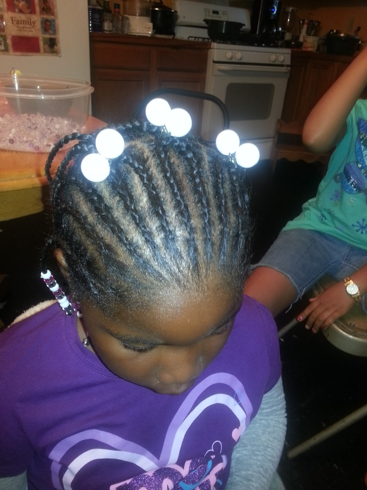 This little girl is in my rotation.. she loves getting her hair done ...
