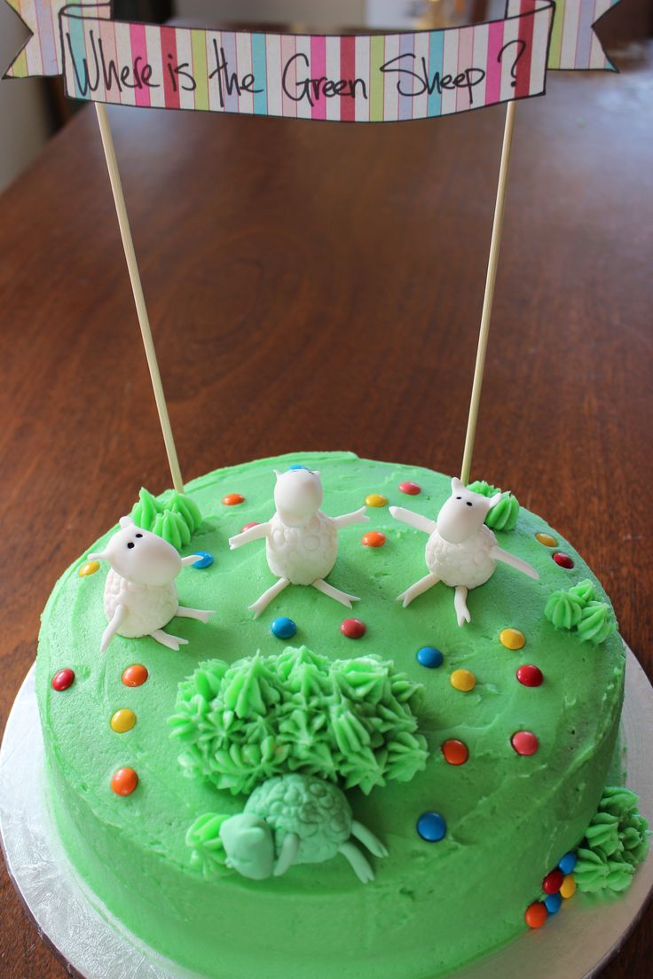 Simple 'Where is the Green Sheep' Cake. Fondant sheep, buttercream icing and mini m&ms for flowers.