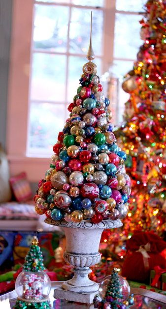 This tabletop topiary was made from a Styrofoam cone, glue and Christams ornaments.  Mark Ballard.