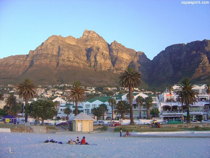 A shot of Camps Bay beach facing the Twelve Apostles mountain range during the early evening.