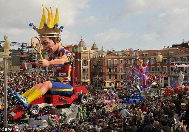 Floats parade through Nice in the 128th Nice Carnival. The theme is 'King of Sport'
