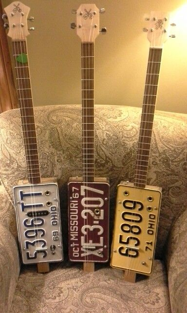 Cigar box guitar using old license plates.