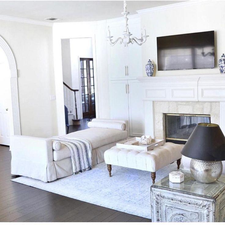White interior. Farmhouse living room. Coastal living room. Neutral living room. Dark wood floors. Decorating around TV. Furniture arrangement #coastallivingroomsdecor #livingroomfurniture #furniturearrangement