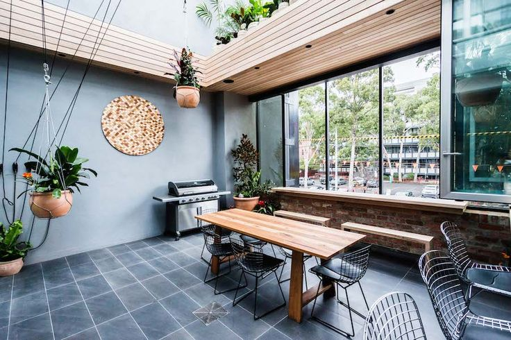 Outdoor terrace with wood features on The Block Glasshouse