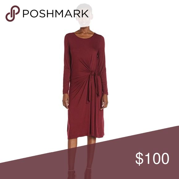 Dress Beautiful light weight ribbed long sleeveless twist dress. This dress is a rich robust Malbec red wine in color. Made of 95% Viscose, 5% Spandex. This dress is new however, the tag was removed therefore the price reflects that. Three Dots Dresses