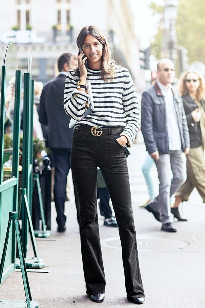 Geraldine Saglio in a black and white striped sweater + black flared jeans + black ankle boots + black Gucci belt