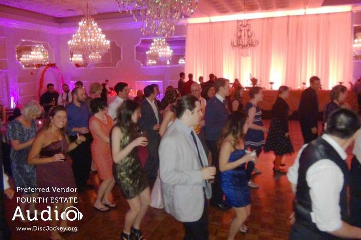 The Cupid Shuffle packs 'em in. Fourth Estate Audio's incomparable Chicago wedding DJ and Chicago wedding lighting professionals stand ready to make your wedding this fun, at http://www.discjockey.org/ #chicagoweddinglighting #chicagouplighting