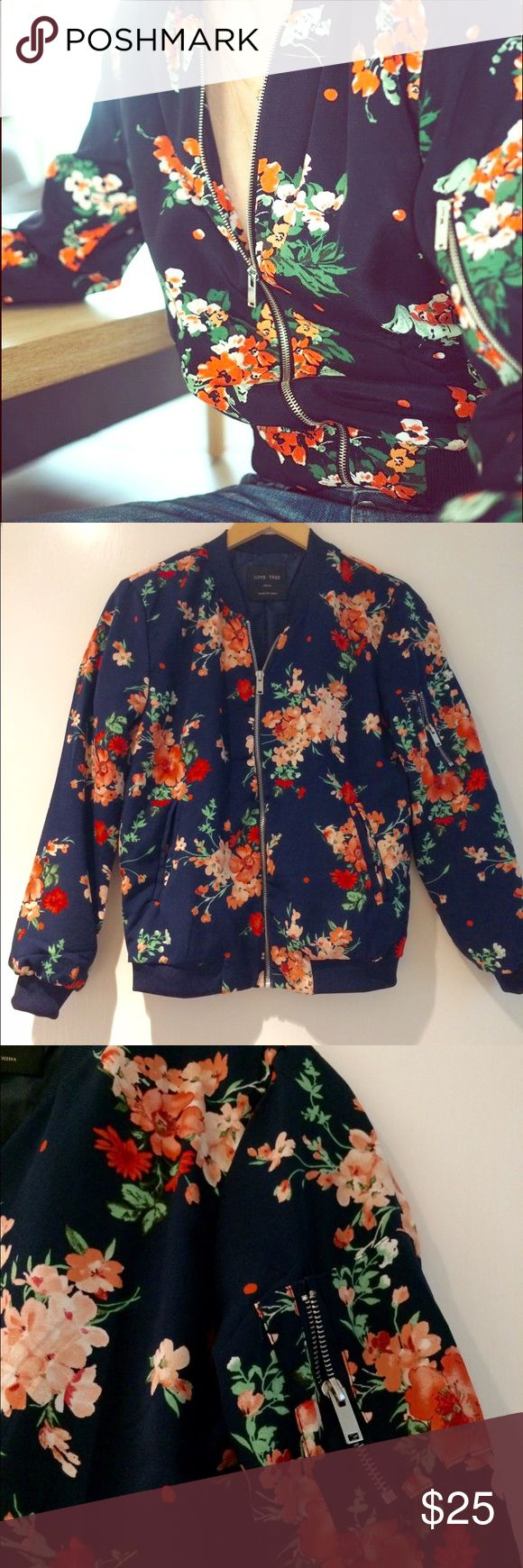 NWOT navy floral bomber jacket Stunning new navy bomber jacket with coral floral pattern. Awesome details like zippered pocket at sleeve. NWOT. First photo is stock, not actual jacket. Reasonable offers considered. Jackets & Coats