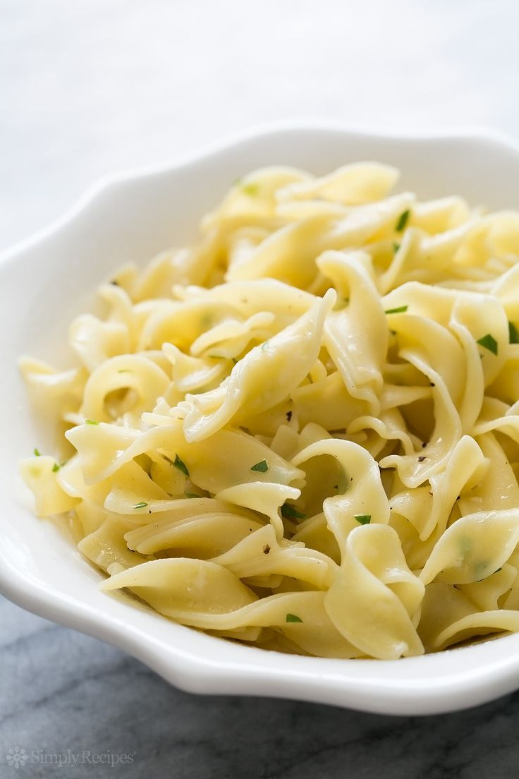 Quick and easy side for a midweek meal! Egg noodles tossed with butter, Parmesan cheese, and parsley. Best side ever to serve with chicken! On SimplyRecipes.com