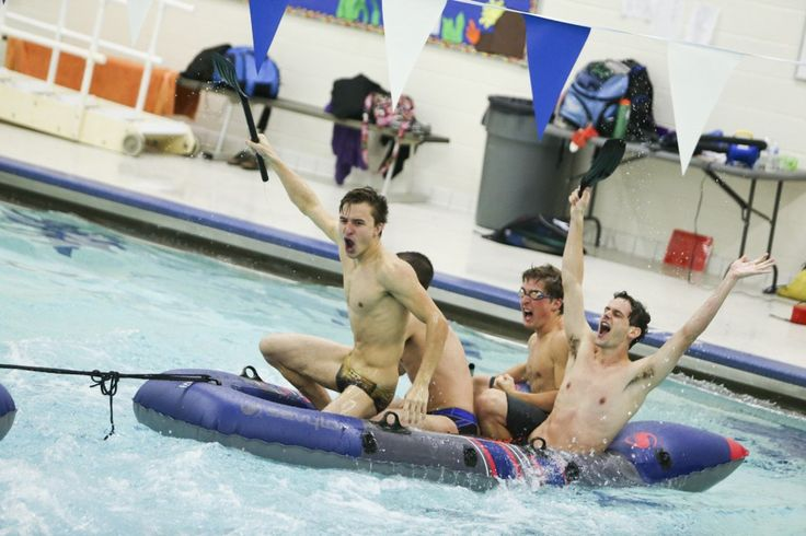 Members of the Western Michigan University Swim and Dive team celebrate their win against Pi Kappa Alpha Fraternity in the homecoming Tug of Oar competition at Gabel Natatorium in Kalamazoo, Michigan on October 22, 2015. (Crystal Vander Weit/Kalamazoo Gazette)
