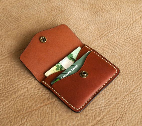A completely hand made item , hand cut and hand stitched . Made from very high quality chestnut bridle leather from Wickett and Craig . The thread is ritza tiger thread in a tan colour. Ritza is widely known as one of the best hand stitching threads available . The stud is brass. Wallet has two pockets . Big enough to hold three to four cards and a few bills folded. Small enough to fit in the front pocket . I try to duplicate the actual colour of the item . But there are variables that play…