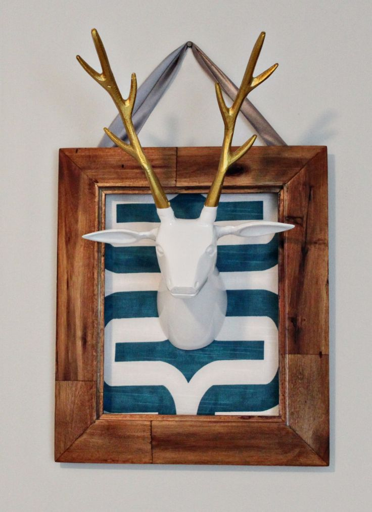 Framed taxidermy in the nursery - so chic and modern! #nursery #nurserydecor