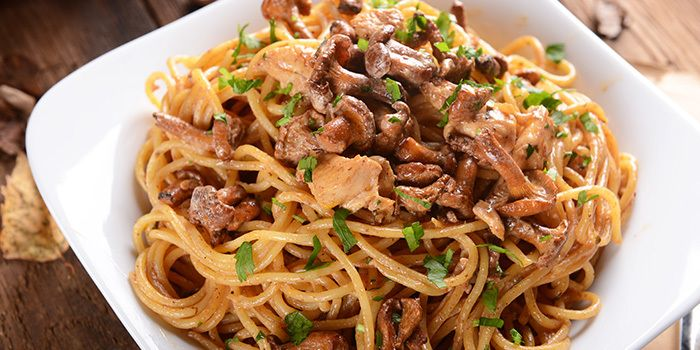 Update basic chicken and mushroom pasta with garlic, flavorful sautéed mushrooms, white wine, and fresh parsley. Get the recipe.