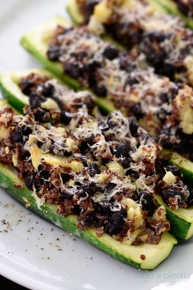 This stuffed zucchini recipe is a delicious dish made of zucchini stuffed with black beans, quinoa and topped with parmesan. A favorite!