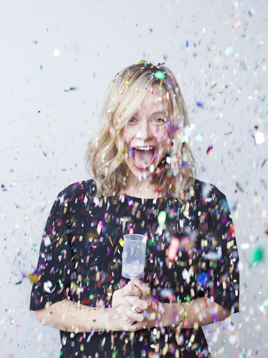 I love this photo from DesignLoveFest's Learning Photoshop in Brooklyn post. I love her expression and the confetti! I would love to take a picture like this! :)
